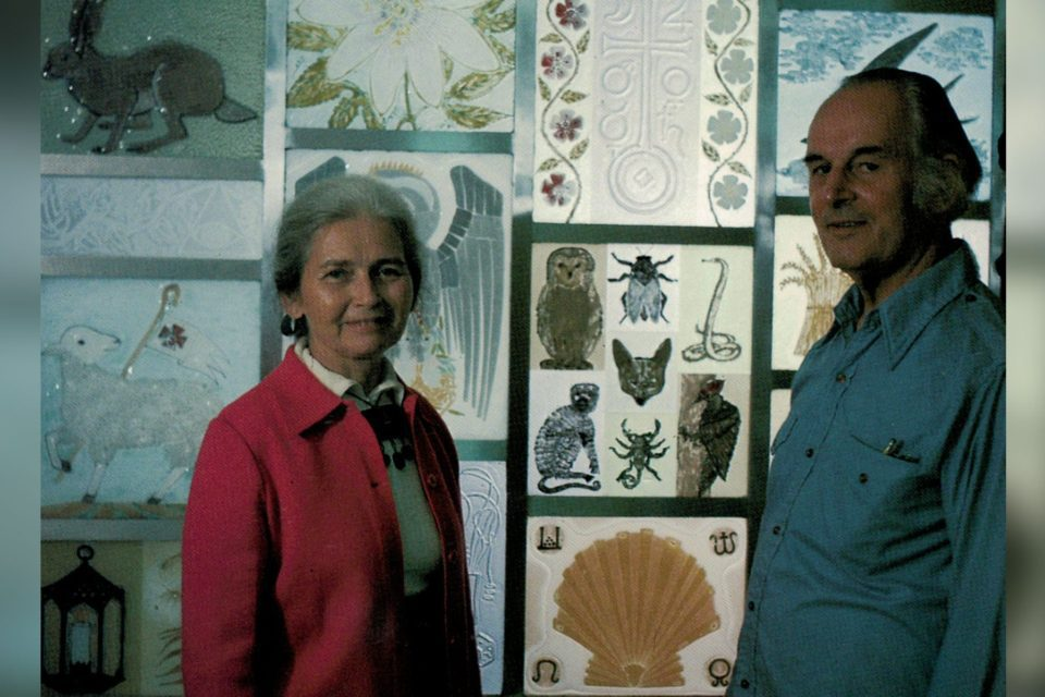 Michael and Fran with church windows they designed