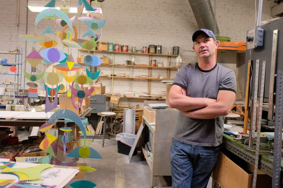 Jonathan Wimmer working on a mobile at Higgins Glass studio.