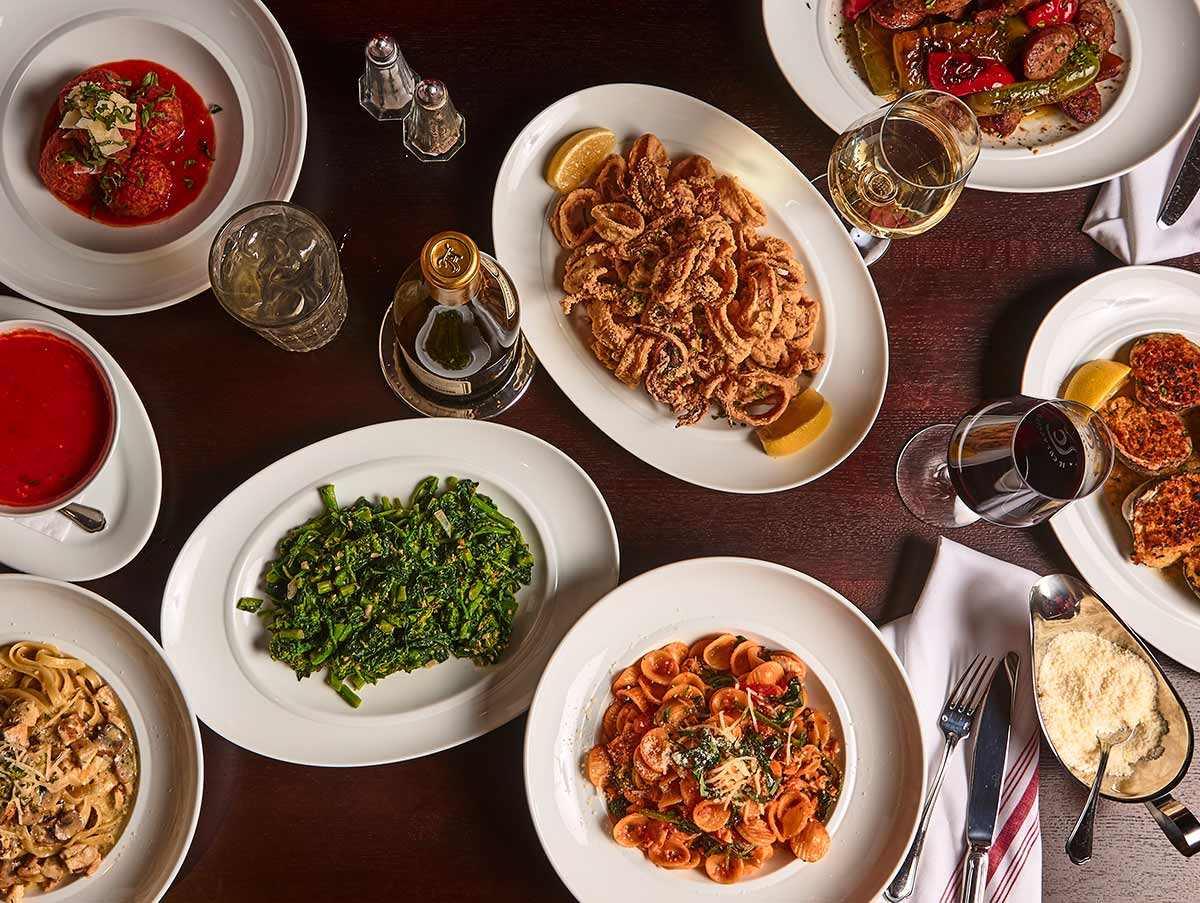 Table filled with the best Italian food in Chicago